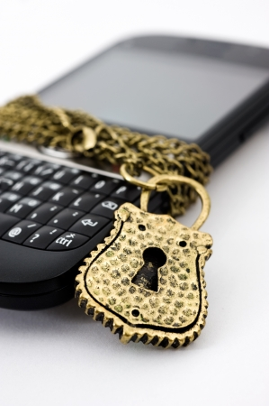 Blocked mobile phone with a chain and lock isolated Stock Photo - 13849444