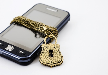 Blocked mobile phone with a chain and lock isolated photo