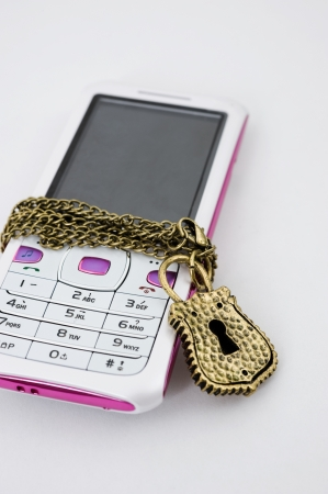 Blocked mobile phone with a chain and lock isolated Stock Photo - 13849432