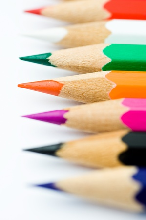 Close up of color pencils with different color over white background. Macro with extremely shallow depth of field    photo