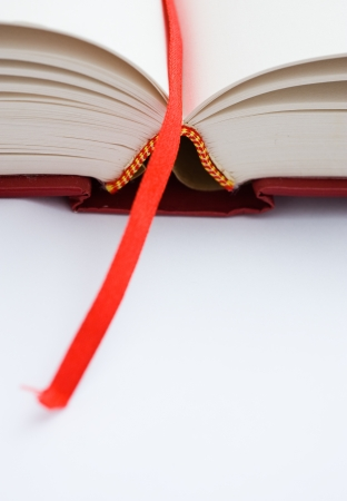 A bookmark in a book helps to find the correct page. Macro with extremely shallow depth of field Stock Photo - 13863090