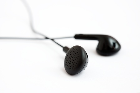 Earphones on white background. Macro with extremely shallow depth of field  photo