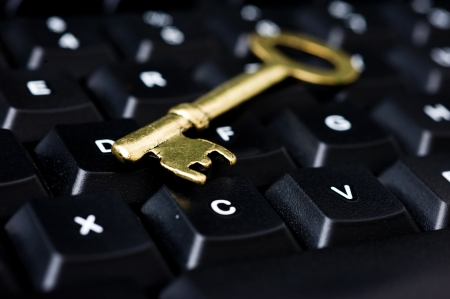 close up of computer with key. internet and network security concept. Stock Photo - 13864215