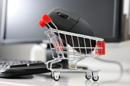 online store: shopping cart with mouse in front of computer , online shopping concept. Stock Photo