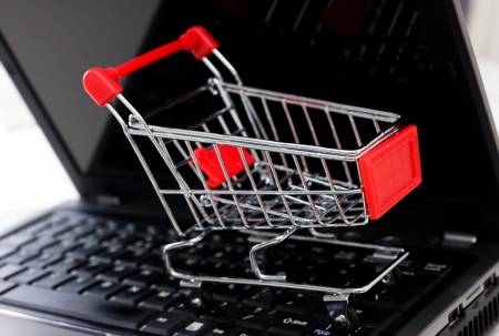 empty shopping cart on the laptop, on-line shopping concept. photo