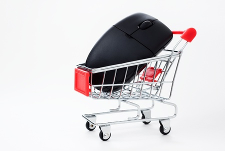 Computer mouse in a miniature-shopping cart. photo