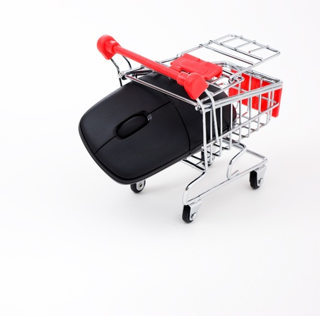 Computer mouse in a miniature-shopping cart. Stock Photo - 13863492