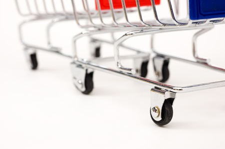 isolated shopping cart on the white  photo