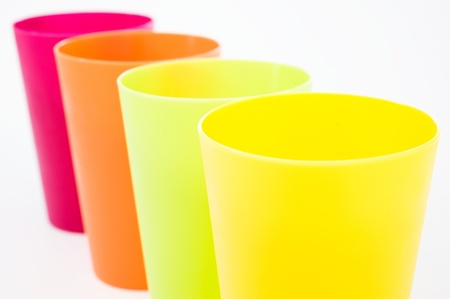 cup four: Plastic cups of various color isolated on white.