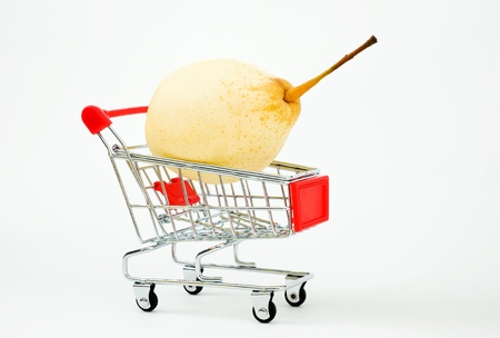 super market: pear in shopping basket isolated.  Stock Photo