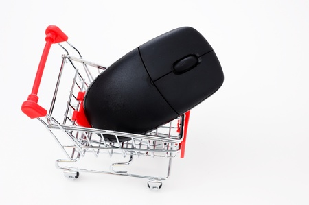 Computer mouse in a miniature-shopping cart. Stock Photo - 13863608