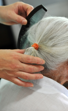 young people comb for an old lady. photo