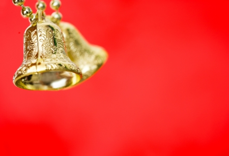 A pair of christmas Gold bells decorations.  Macro with extremely shallow depth of field  photo