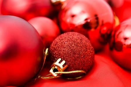 christmas bulbs: background of many red christmas balls. Stock Photo