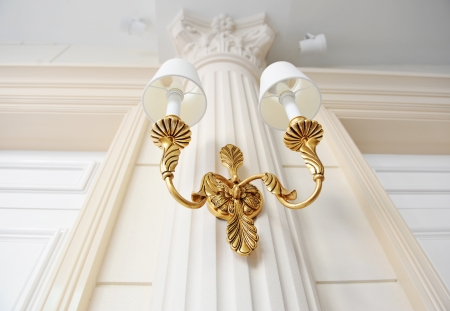 classical gold lamp on the wall.   photo