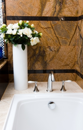 Modern luxury bathroom with flower. photo