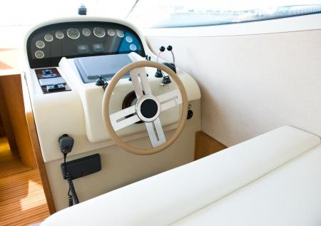 steering wheel on a luxury yacht cabin. photo