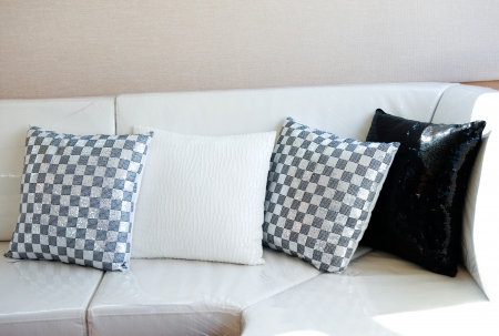 Comfortable corner in family room, with multi-colored pillows. Stock Photo - 13884078