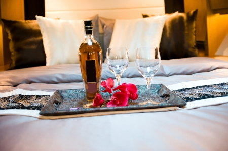 wine glasses on tea-tray in the bed of a luxury yacht.  photo