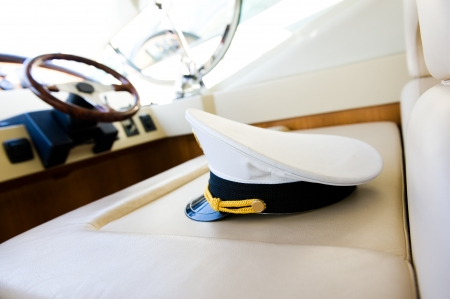 manage transportation: Rudder, compass and captains hat on yacht  Stock Photo