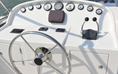 gearshift: steering wheel on a luxury yacht cabin.