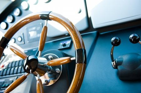 captain ship: steering wheel on a luxury yacht.
