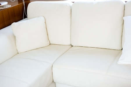 Comfortable corner in family room, with many white pillows.  photo