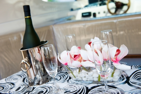 Champagne flutes and ice bucket in a yacht. photo