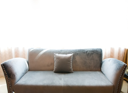 modern sofa standing in front of curtain. Stock Photo - 13883535