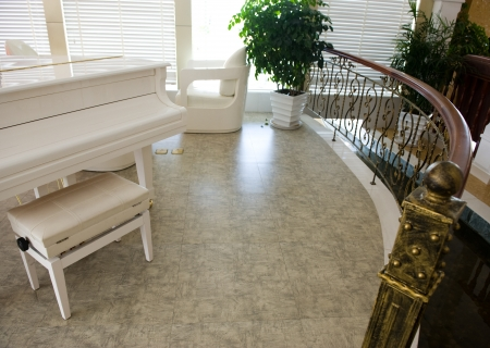 Home interior living or music room with white piano.