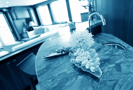 pearls in a tray in ultra modern kitchen, blue tone.  photo