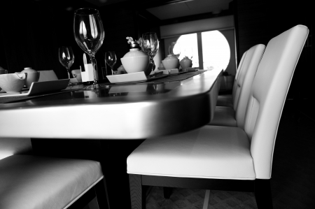 Table set for a elegant dinner , black and white.  photo