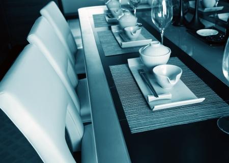 Table set for a elegant dinner , blue tone.  photo
