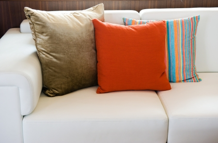 Comfortable corner in family room, with multi-colored pillows. Stock Photo - 13974228