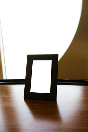 vintage photo frame on table.  photo