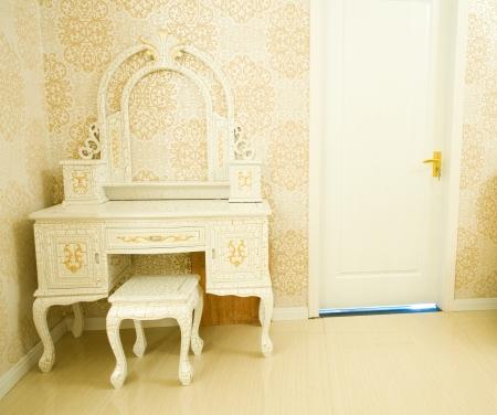 modern dresser in the corner. photo