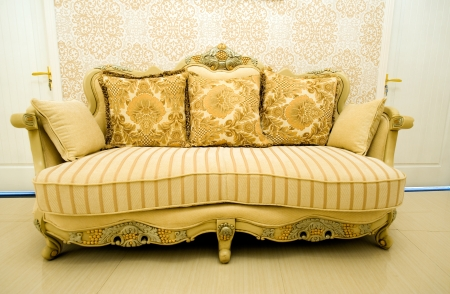 Classic sofa front of wall photo