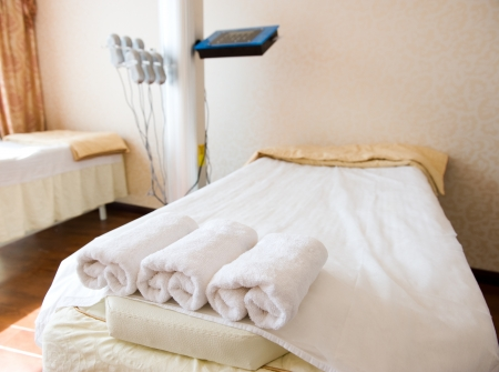 therapy room: bed in a beauty saloon, with machines for treatments. Stock Photo