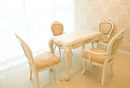 Elegant simple table and chairs in the dining room  photo