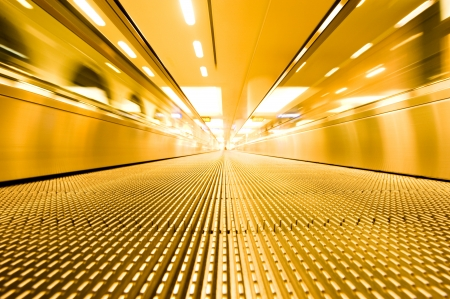 moving escalator of walkway in the airport. Stock Photo