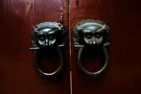 Old chinese door ornament , lion door knockers. photo