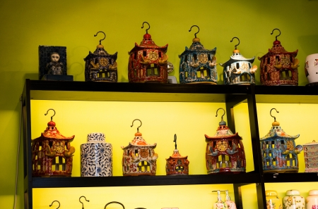 many traditional Chinese wedding lamps on the shelf with yellow background.  photo