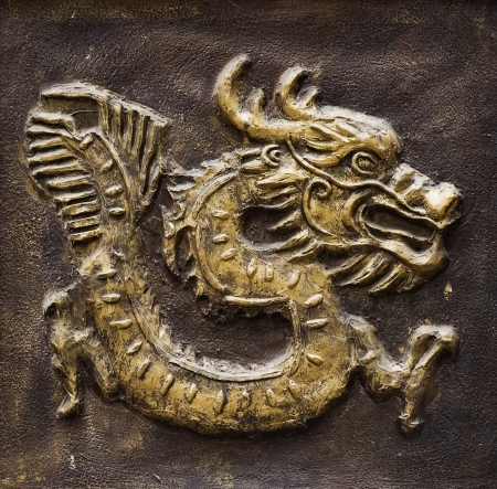 workship: Chinese golden dragon at the wall. Stock Photo