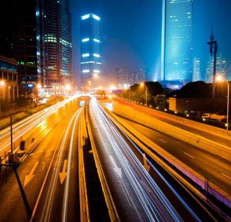 Urban city at night with traffic and night skyline, shanghai China.   photo
