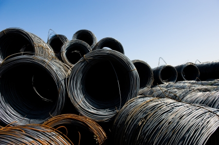reinforcing bar: Roll off thick steel fitting, steel background. Stock Photo