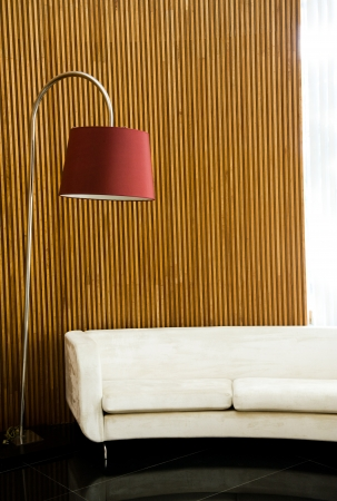 Modern and clean decoration of an apartment with a sofa and a lamp   photo