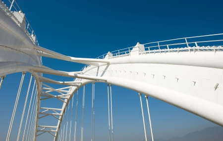 bridge construction: Abstract view of bridge support against a blue sky.