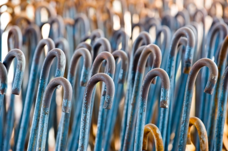Horizontal shot of textured rusty iron rods in closeup.  photo