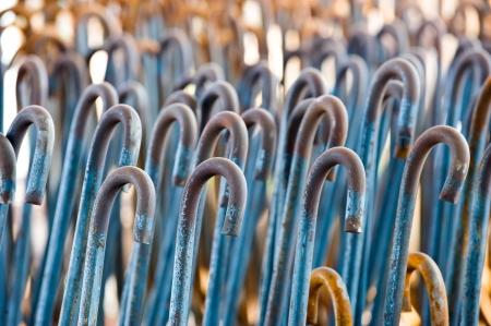 strenghten: Horizontal shot of textured rusty iron rods in closeup.