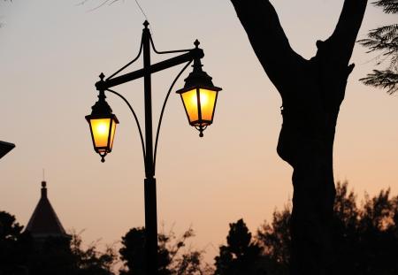 Night shot close-up of an legant streetlamp  photo